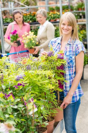 smiling woman at garden center shopping