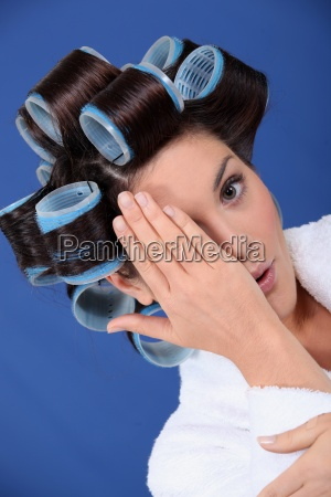 woman wearing her hair in rollers