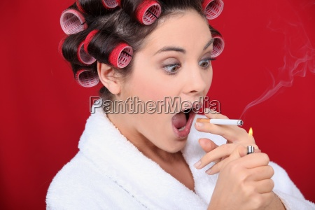 woman with curlers and lit cigarette