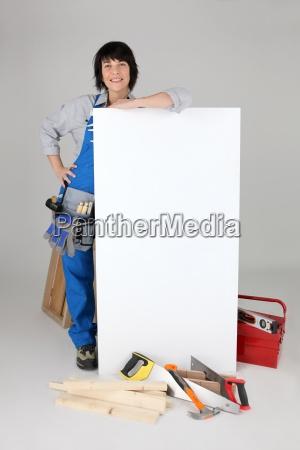 female carpenter with a board left