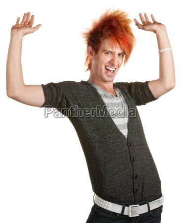man with mohawk holding something up