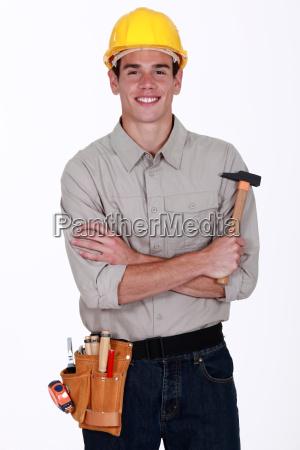 happy craftsman holding a hammer