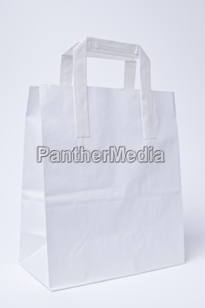 white carrying bag against white background