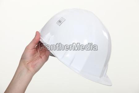 hand holding hard hat