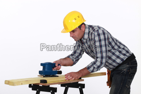 workman using a power tool