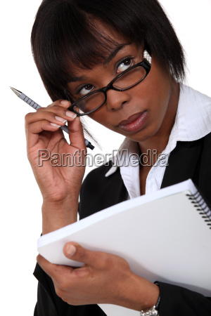 afro american businesswoman holding a notepad