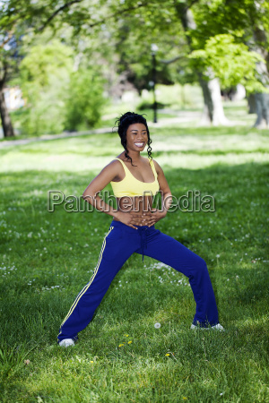 young african american exercising in park