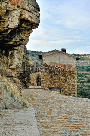 small spanish old town with mountains