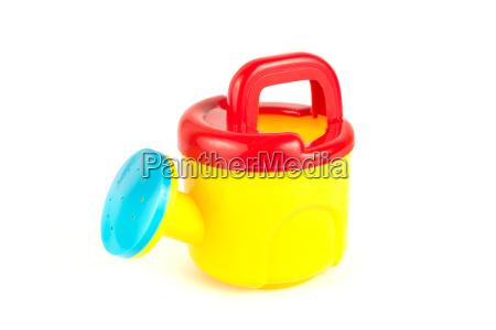 rote und gelbe giesskanne kunststoff spielzeug