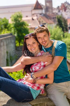 young happy couple embracing on balcony