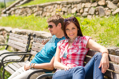 young couple relaxing on bench in