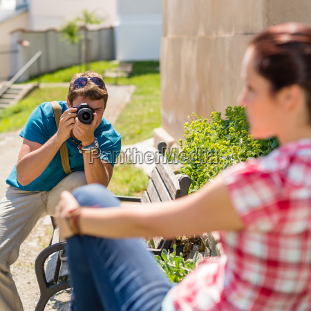 man taking picture of woman on