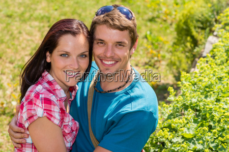 young happy couple embracing in sunny