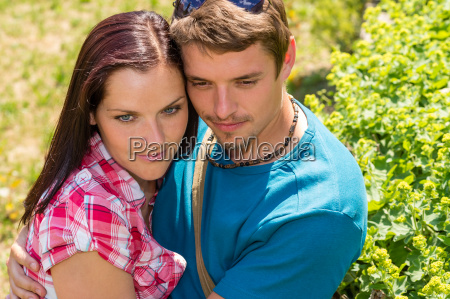 happy affectionate young couple hugging in