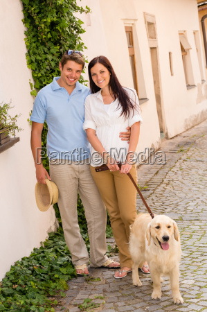 modern couple with dog in romantic