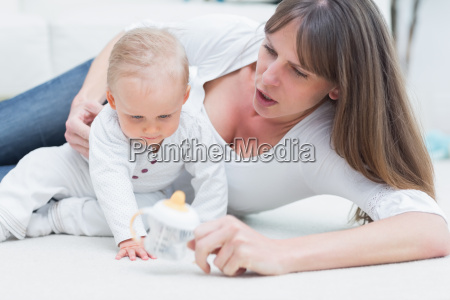 baby and mother sitting on the