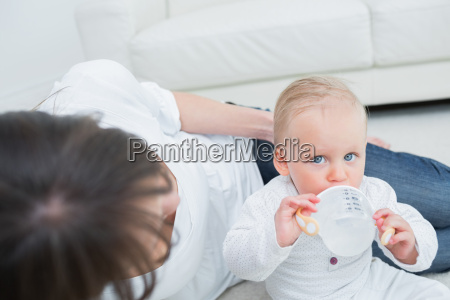 baby drinking a bottle of water