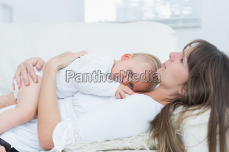 baby lying on the chest of