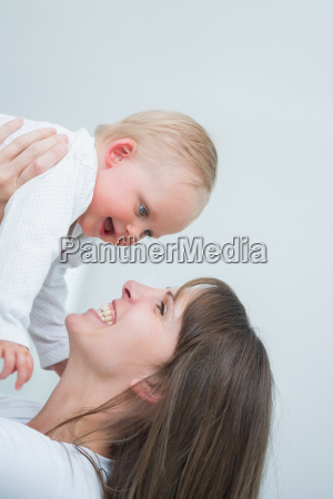 smiling mother holding her baby in