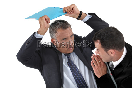 businessman hitting a colleague with a