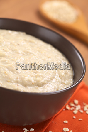 cooked oatmeal porridge with maca powder
