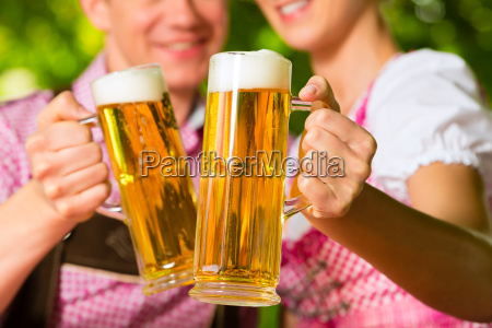 happy couple with beer in beer