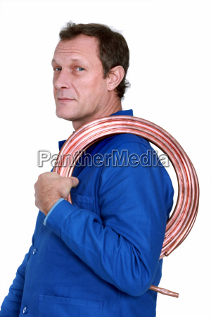 plumber with a reel of copper