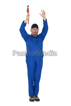 man with wrench and raising arms