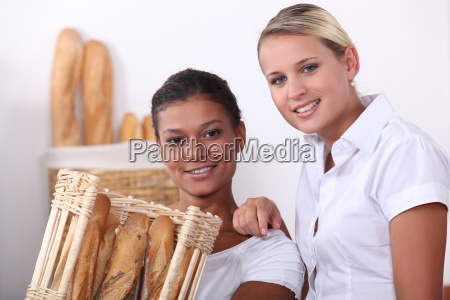 two shop assistants working in a
