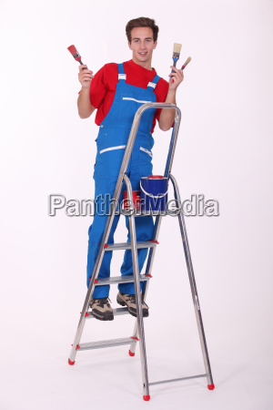 young painter on ladder isolated on