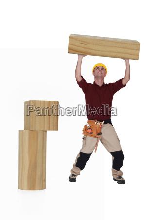 carpenter lifting wood