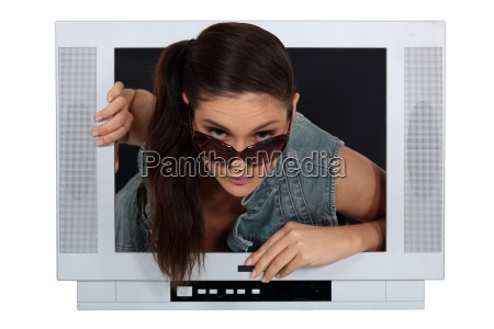 woman climbing out of a tv