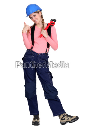 tradeswoman giving the thumbs up and