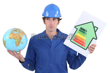 tradesman with a globe and energy