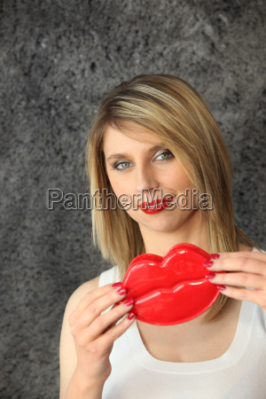 blond woman holding comedy plastic lips