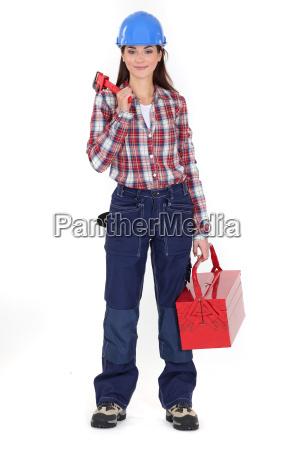 a handywoman with a tool box