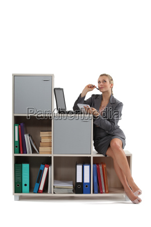 attractive blonde working on laptop indoors