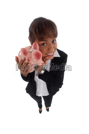 happy young businesswoman with piggy bank