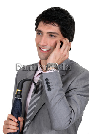 a polished businessman talking on his