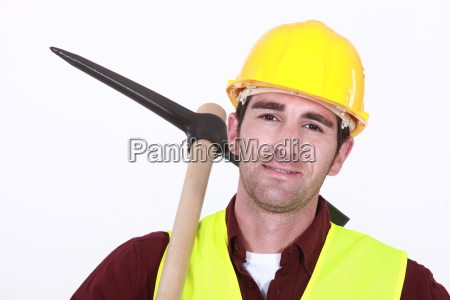 construction worker holding pick axe