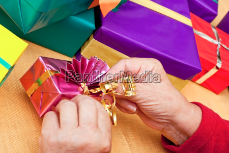 senior sitting and packed gifts on