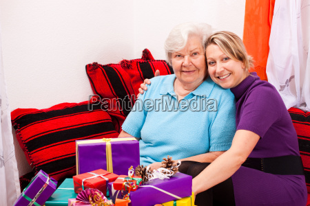 mother and daughter sitting on sofa