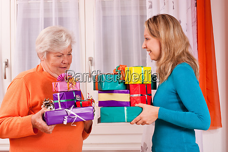 old woman and young woman give