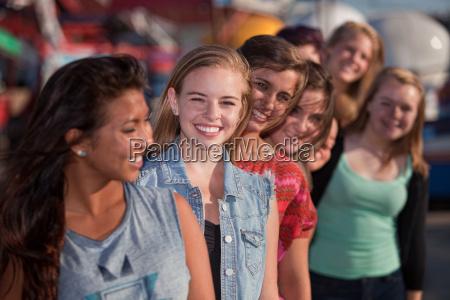 smiling teen girls in line