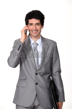 a businessman holding a phone and