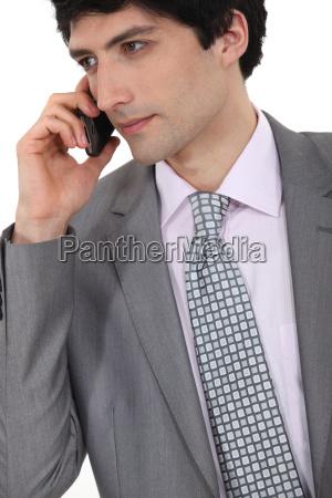 portrait of successful businessman making telephone