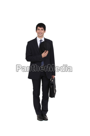 portrait of beaming businessman with briefcase