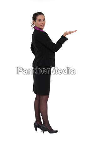 woman standing holding invisible object