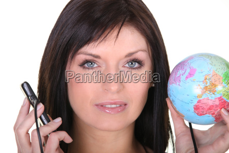 woman holding globe and cell phone