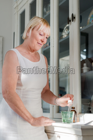 health issues old woman taking prescription